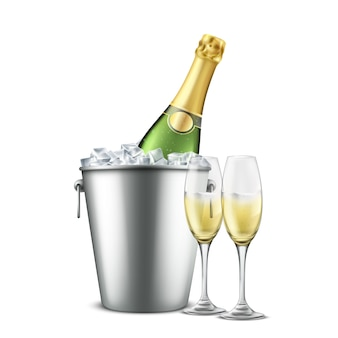Bottle of champagne in restaurant bucket with ice and wine glasses with carbonated alcohol beverage