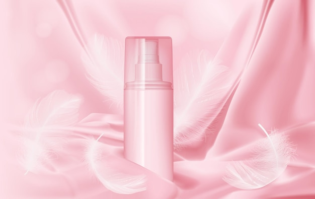 Bottle with perfume on pink silk and feathers