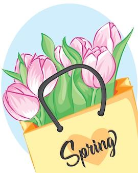 白いテーブルの上にクラフト紙で包まれたピンクのチューリップの花束。紙袋に入ったピンクのチューリップ。結婚式のグリーティングカードのバナー、母の日カード、女性の日、誕生日、その他の休日の背景。