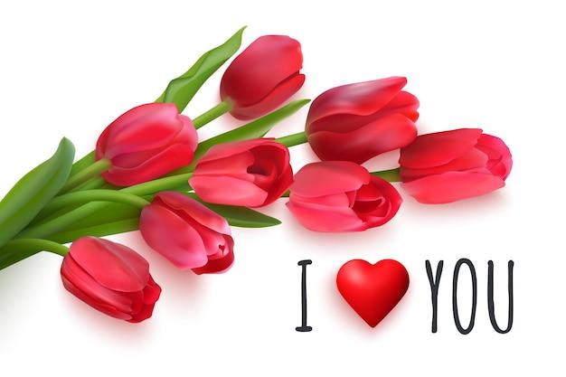 白い背景の上の赤いチューリップの花束。手書きのテキスト愛しています