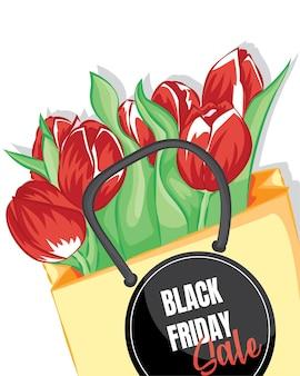 흰색 테이블에 공예 종이에 싸인 빨간 튤립 꽃다발. 종이 봉투에 빨간 튤립입니다. 검은 금요일 판매 템플릿의 배경입니다.