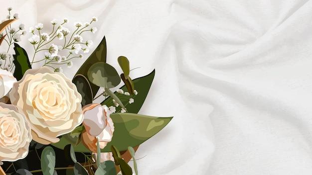 白い絹の織り目加工の背景にブーケ