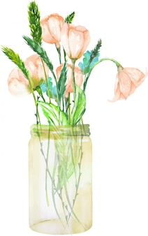 Bouquet of pink wildflowers in a glass jar