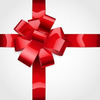 빛나는 빨간 리본으로 만든 활. 선물 장식.