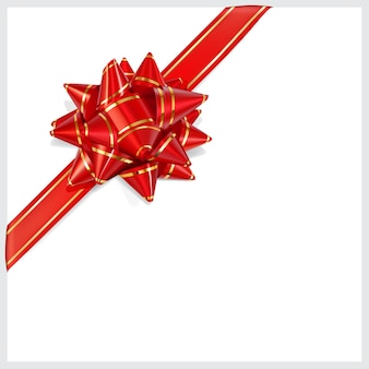 Bow of red ribbon with gold stripes with shadow on white background. located diagonally