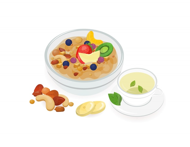 Bowl of tasty oat porridge decorated with fresh tropical fruits and cup of hot green tea isolated