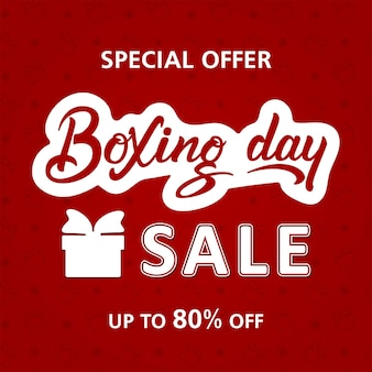 Boxing day sale hand lettering square template on red background with gift boxes.