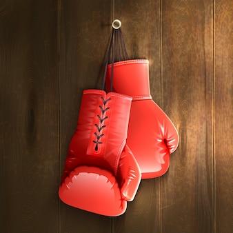 Боксерские перчатки на стене