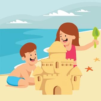 男の子と女の子がビーチで一緒に砂のお城を作っています。