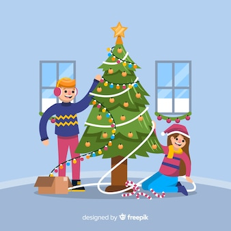 男の子と女の子のクリスマスツリーを飾る