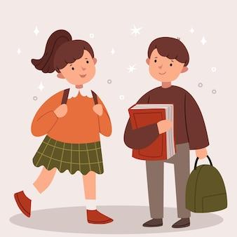 소년과 소녀는 학교에 간다. 현대 학교 교복입니다. 책과 배낭.