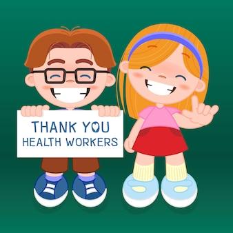 소년과 소녀 표지판을 들고 코로나 바이러스와 싸우는 병원에서 건강 근로자에게 감사합니다 (covid-19)