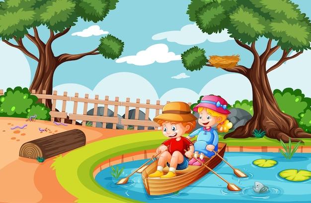 男の子と女の子が自然公園でボートを漕ぐ