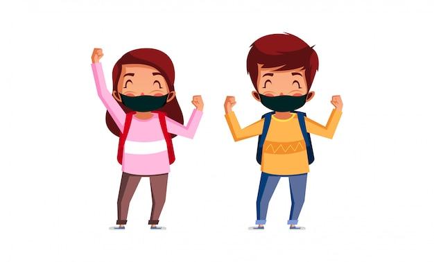 소년과 소녀 착용 마스크는 학교에 갈 수 있기 때문에 행복합니다.