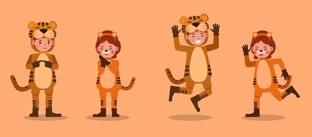 Мальчик и девочка в костюмах тигра. представление в различных действиях с эмоциями.