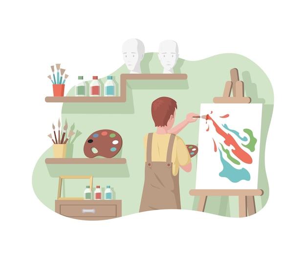 Мальчик в фартуке рисует абстрактную картину
