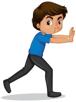 Boy in blue shirt pushing wall on white