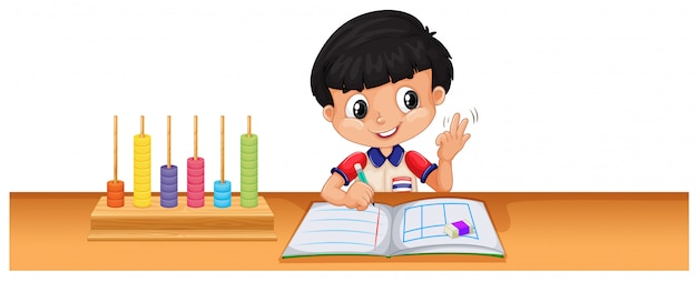 Boy calculating math on the desk