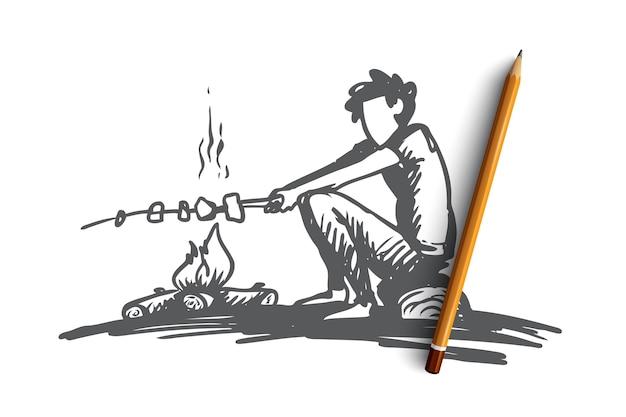 少年、キャンプファイヤー、夏、休息、スカウトのコンセプト。手描きの少年は焚き火の近くに座って、マシュマロのコンセプトスケッチをローストします。