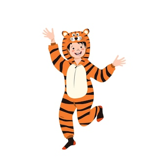 A boy in a carnival costume of a tiger. children pajama party. kid wearing jumpsuits or kigurumi, festive clothing for new year, christmas or holiday
