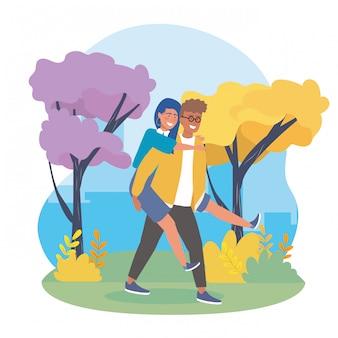Мальчик несет девочку в спину с деревьями