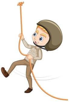 孤立した背景にロープを登る少年
