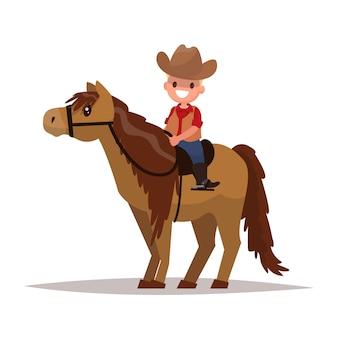 Мальчик ковбой на лошадях.