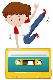 テープカセットのヒップホップをしている少年