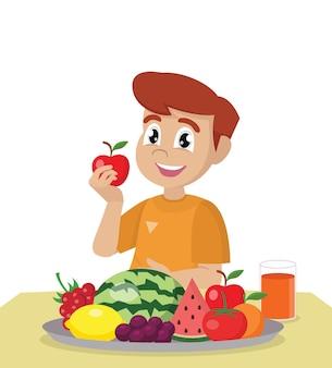 Мальчик ест свежие здоровые фрукты