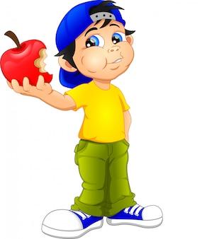 少年は赤いリンゴを食べる