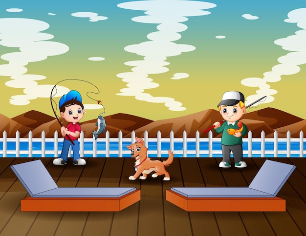 少年は桟橋で釣りを楽しんでいます