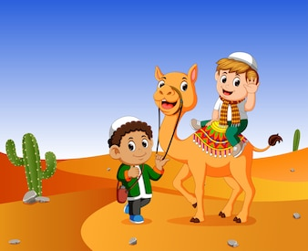 Boy get into a camel in the wasteland and the men guide the camel
