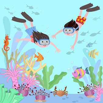 Boy and girl diving underwater.