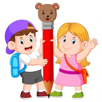 The boy and the girl is holding the big pencil