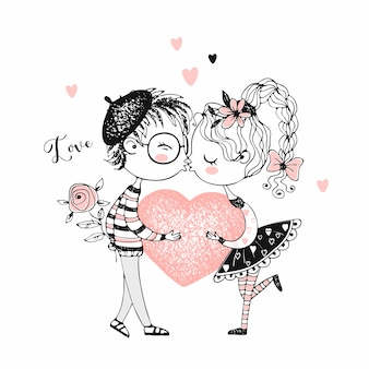 A boy and a girl kiss and hold a big heart.