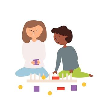 男の子の女の子は教育ゲームをプレイし、形を収集します