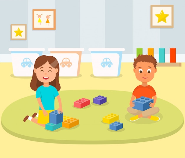 Boy and girl playing building blocks in play room