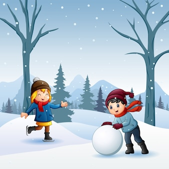 Boy and girl playing snowball fight outdoors