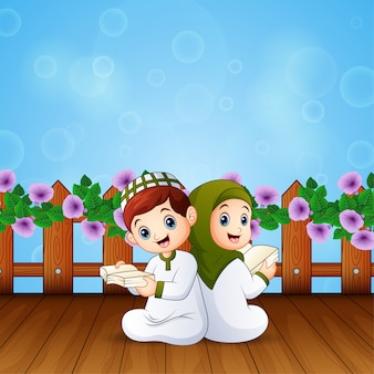 Boy and girl reading book for islamic festivals celebration