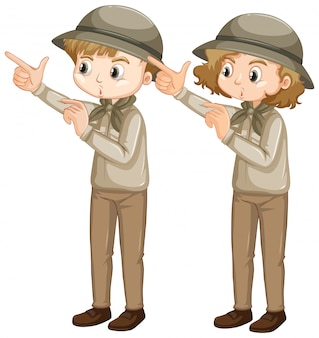 Boy and girl in scout uniform pointing finger