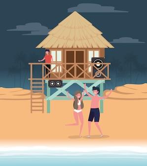 Boy and girl with swimwear dancing on the beach