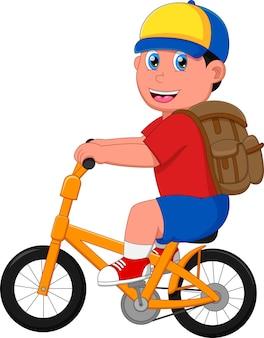 Мальчик ехать в школу на велосипеде