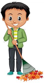 Boy in green jacket raking leaves on white
