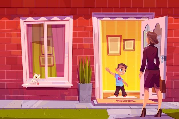 家のドアで母親に挨拶する少年