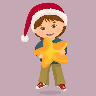 Boy holding a big star in his hands