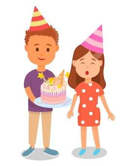 Boy holding cake for birthday girl congratulating.