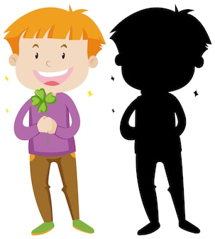 Мальчик держит лист клевера в цвете и силуэте