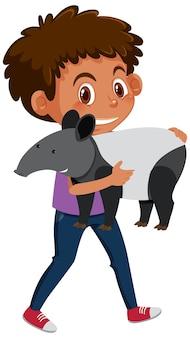 白い背景で隔離のかわいい動物漫画のキャラクターを保持している少年