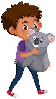 かわいい動物の漫画のキャラクターを保持している少年