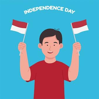 Мальчик держит флаг индонезии празднует день независимости